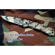 Нож Tekut Stealth Jet серии Fashion, лезвие 67 мм, рукоять - алюминий, камуфляжная, креп на ремень